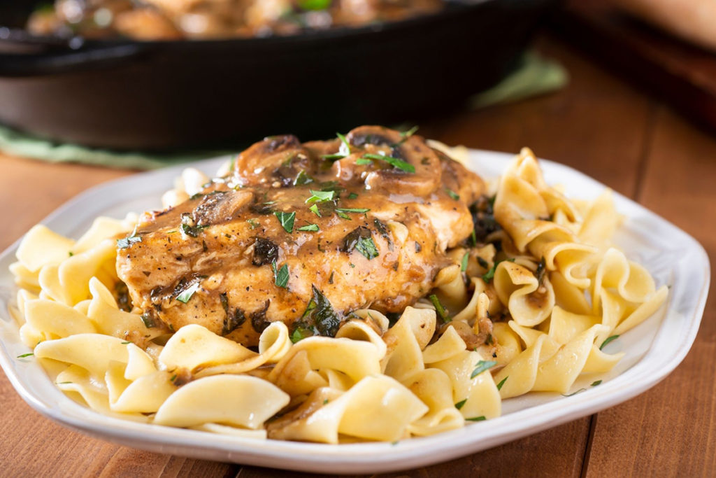Noodles served with Chicken Marsala
